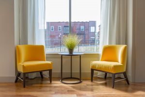 two yellow padded chairs